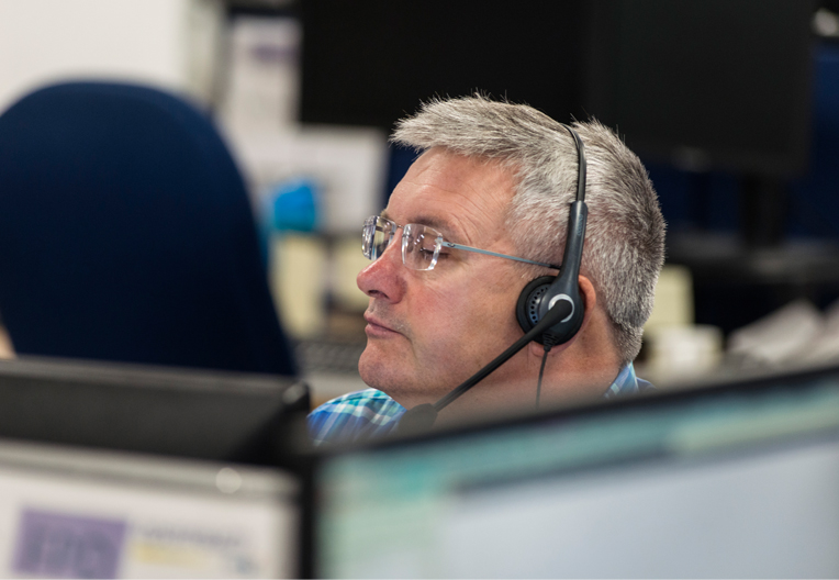 Image of office worker wearing a headset