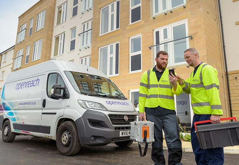 Engineers by an Openreach van