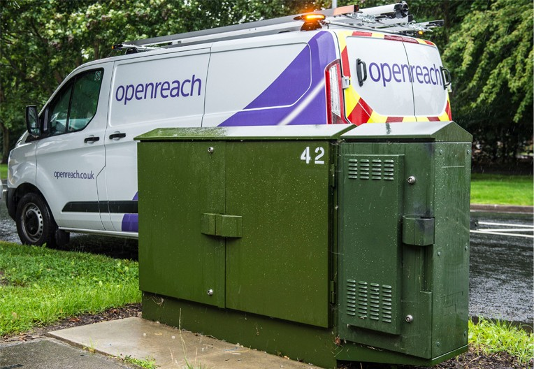 Image of a green street cabinet and Openreach van