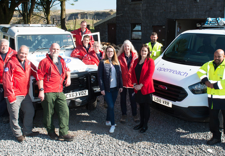 Image of cave rescue team with an Openreach engineer