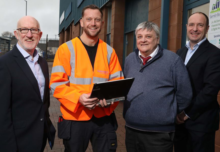 Openreach engineer with representatives from the Ballymena Business Centre.